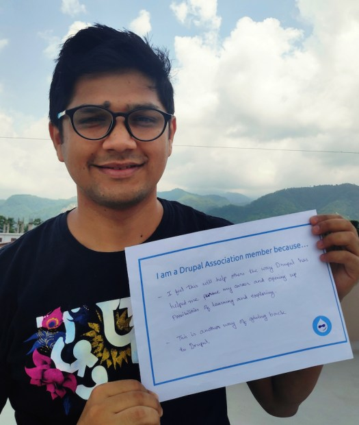 Jaideep's photo holding sign saying why they are a member