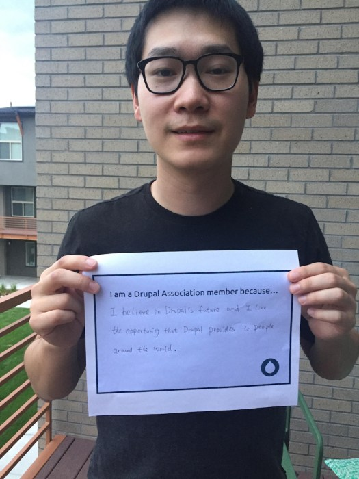 Jiang Zhan's photo holding sign saying why they are a member