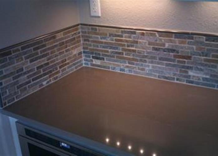 kitchen remodel stone backsplash