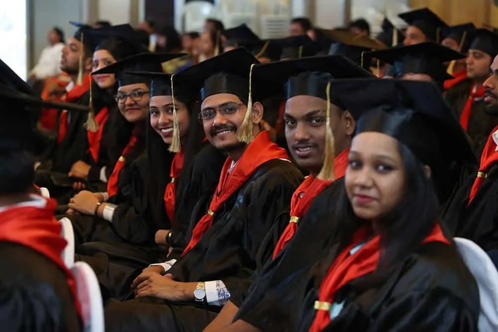 student in Convocation Gowns in graduation ceremony