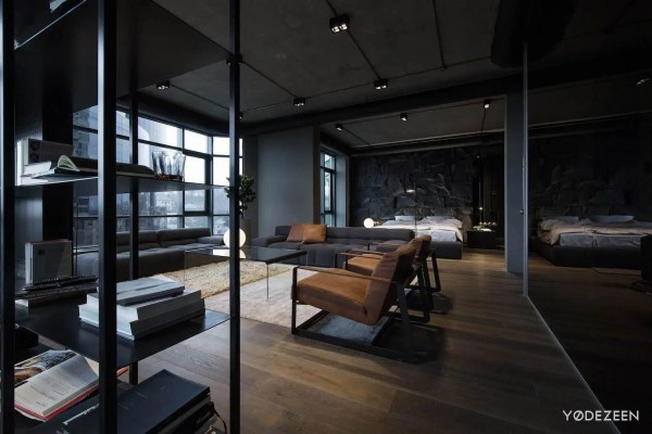 Apartment In Concrete Dark Surfaces And Dramatic Lighting