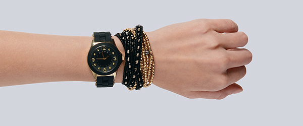 Marc by Marc Jacobs black and gold watch with black face ($200 at Von Maur). Chan Luu multiple-wrap woven bracelet in black ($195 at Von Maur). Gold seed multiple-strand bracelet ($15 at Dornink).