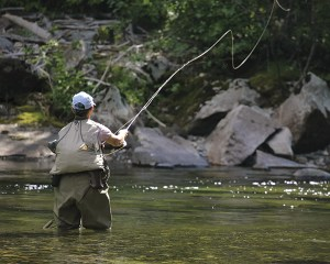 No bobber-and-worm enterprise, fishing in the Tetons involves casting flies to trout in mountain streams.