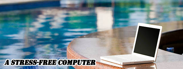 Picture of laptop computer, relaxing by a resort pool - all your computers could be like this computer