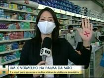 Um X vermelho na palma da mão: sinal de pedido socorro para vítima de violência