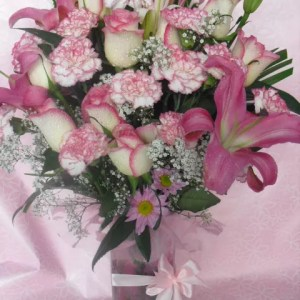 pink lilies roses carnations in vase