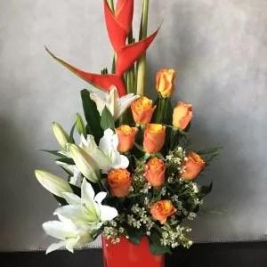 white lilies orange roses vase