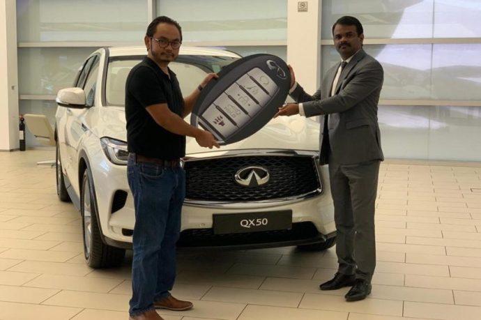 ARABIAN AUTOMOBILES hands over INFINITI QX50 to lucky DSF winner