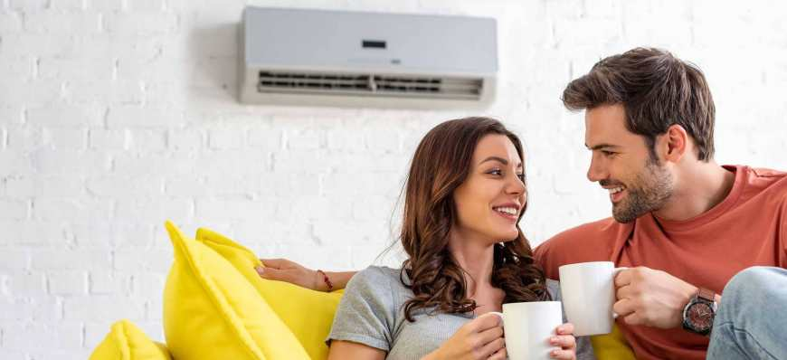 couple enjoying cool air from split ac