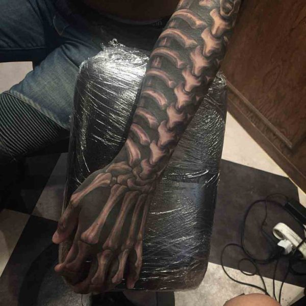 skeleton arm tattoo
