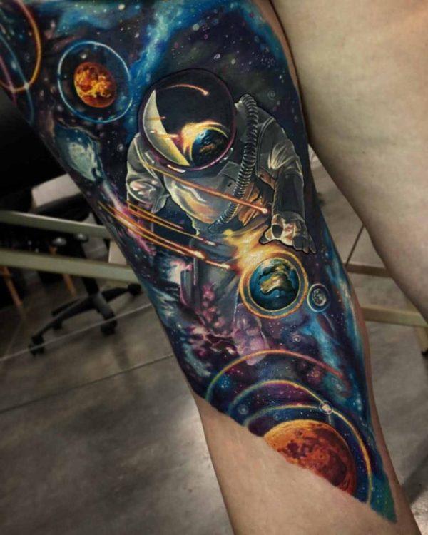 space tattoo leg