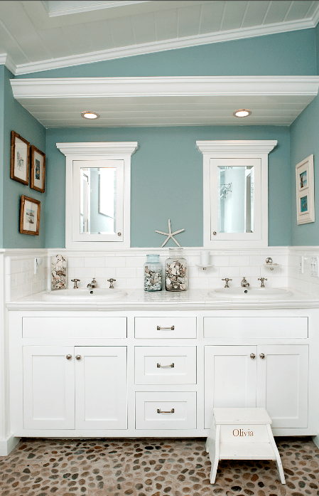 My Laguna Beach cottage bath kept the family together with dual sinks and mirrors. Olivia's step stool gave a growing girl independence.