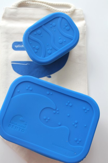 Reusable bento boxes with colorful lids and insulated steel are green and better looking than a Ziplock.