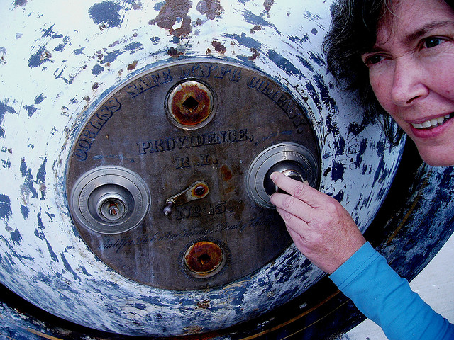 Women and Antique Safe - Photo By Kathleen Tyler Conklin