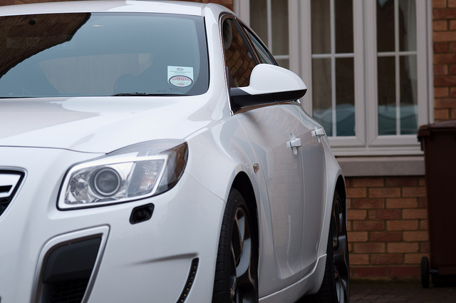 How To Keep Car Costs Down - White Vauxhall Insignia Car