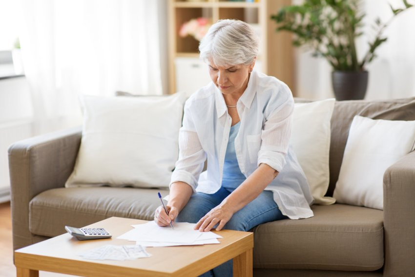 Seniour Women Calculating Finances