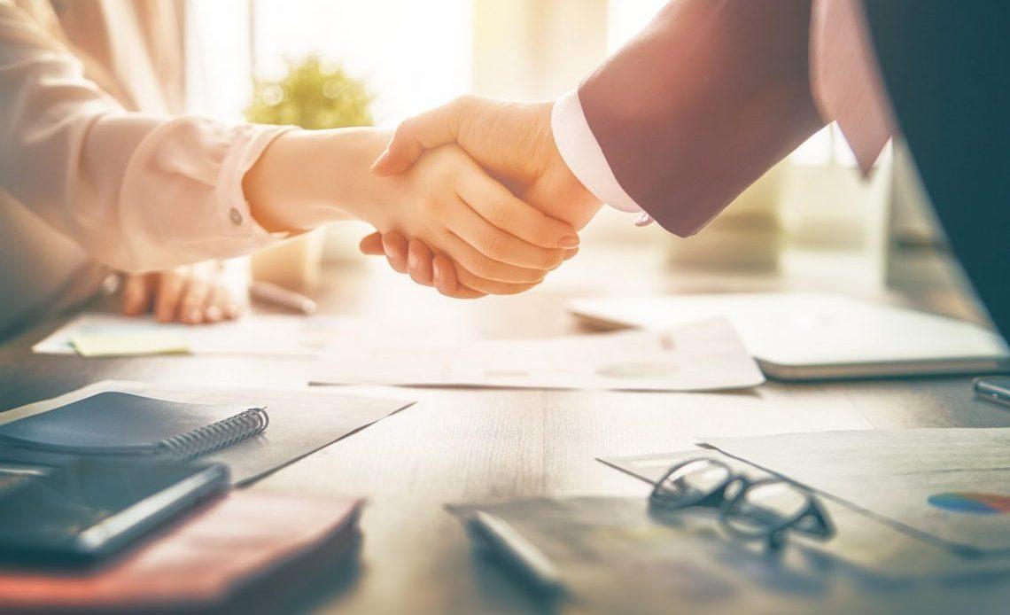 Business Women and Man Shacking Hands