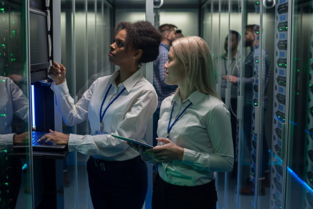 Women Looking At Server