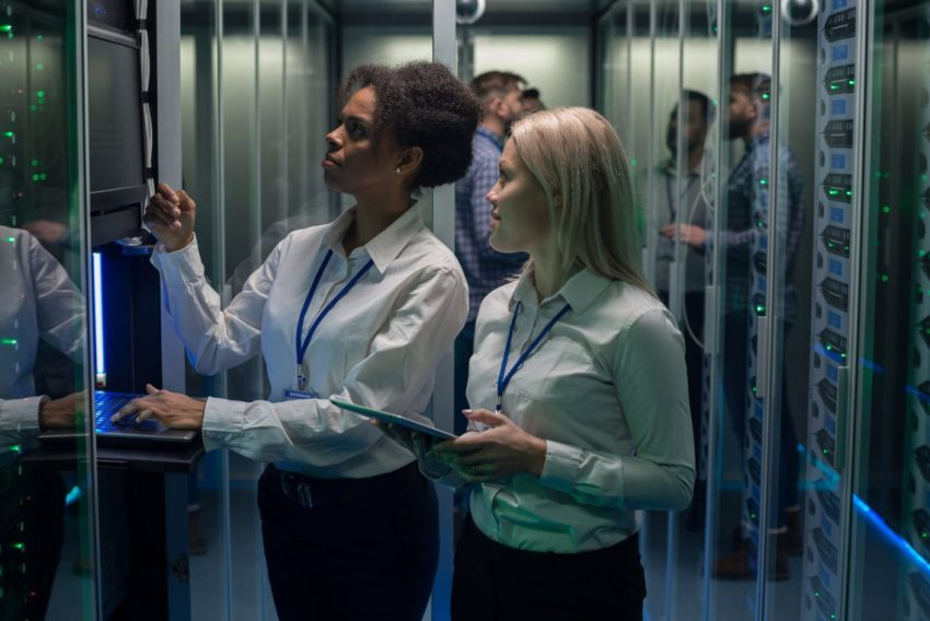 Women Looking At Server