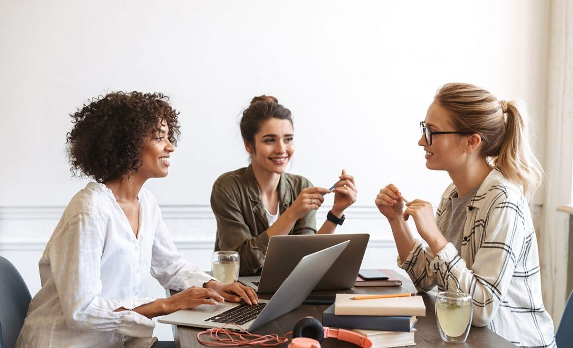 Women employer talking with women employees