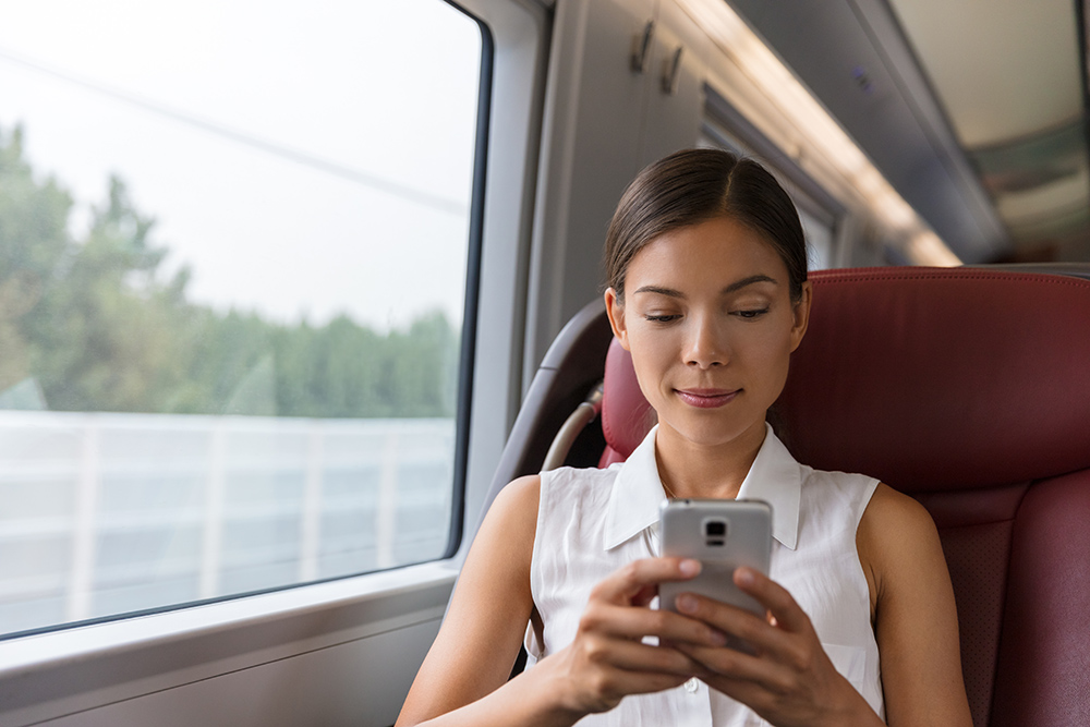 Women on train with mobile phone