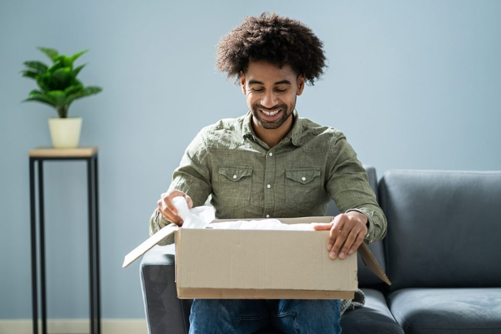 Man looking at box of delivered items