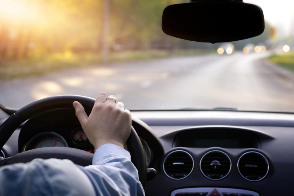 Driving car. hands on steering wheel