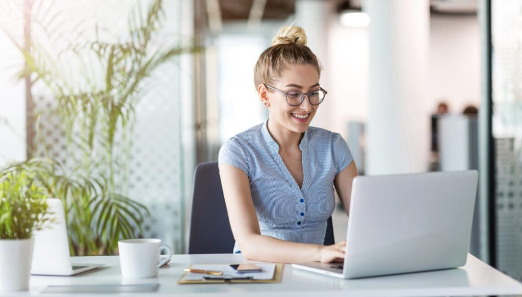 Young business woman on laptop