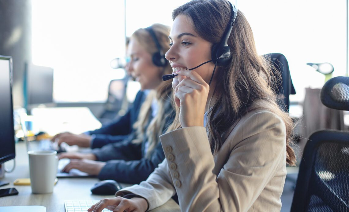 Women Call Centre Employee Taking Calls.