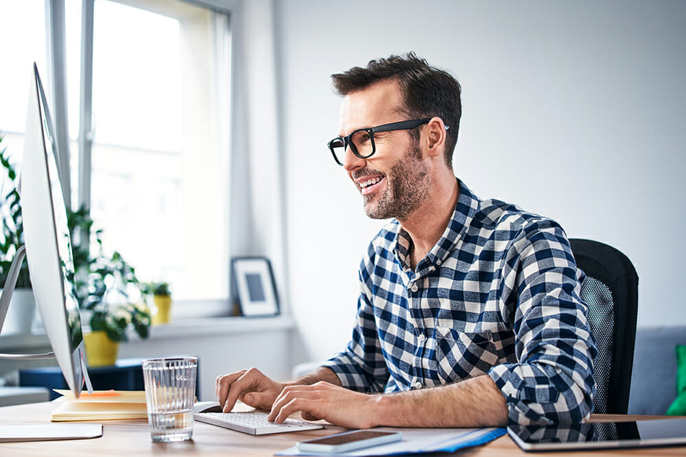 Man sat at desk with computer