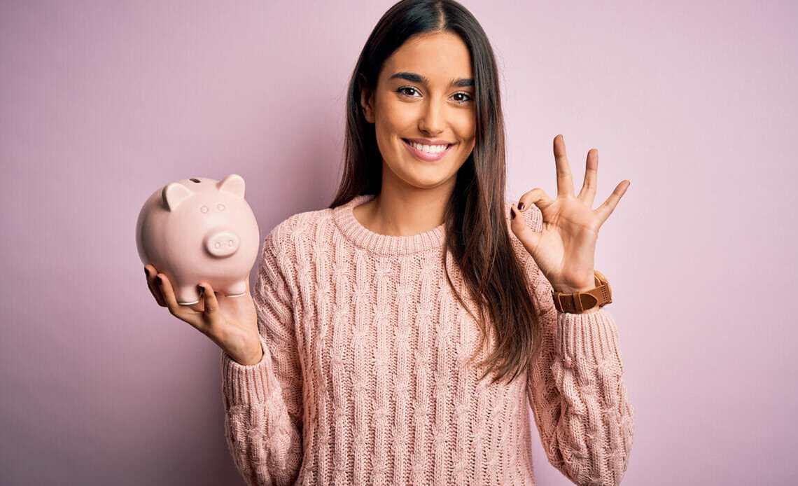 Women holding piggy bank