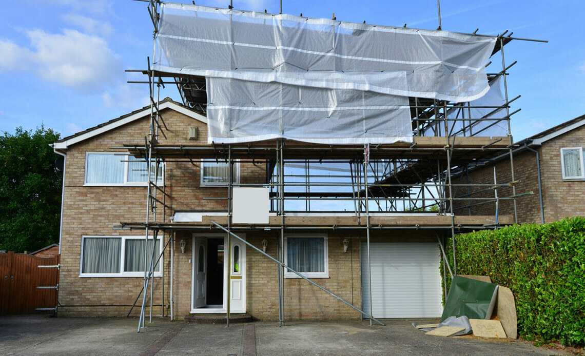 Detached House With Scaffolding