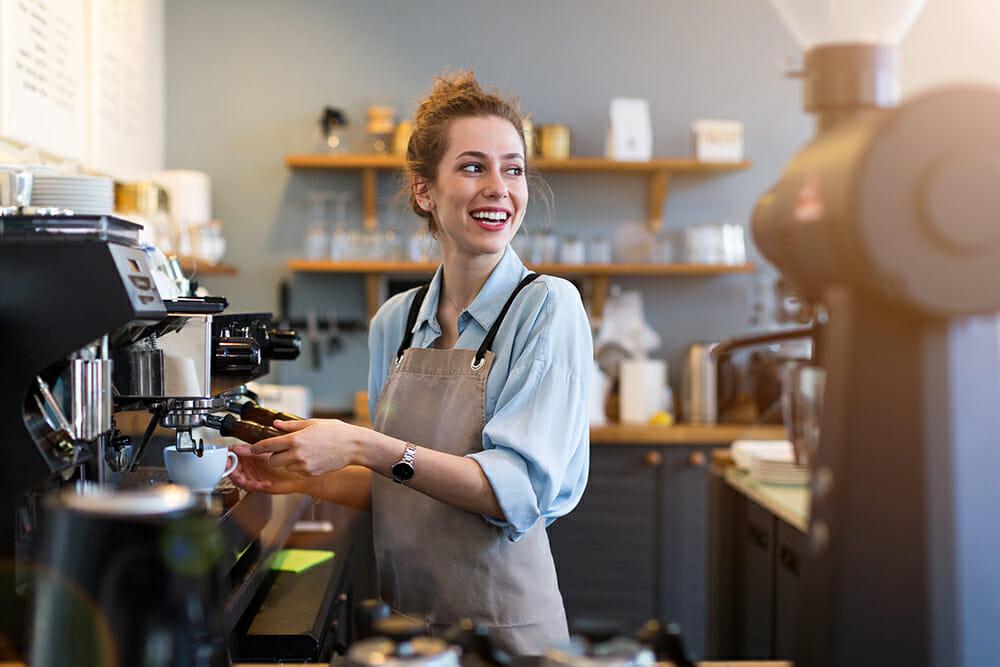 Women working in coffee shop making coffee.