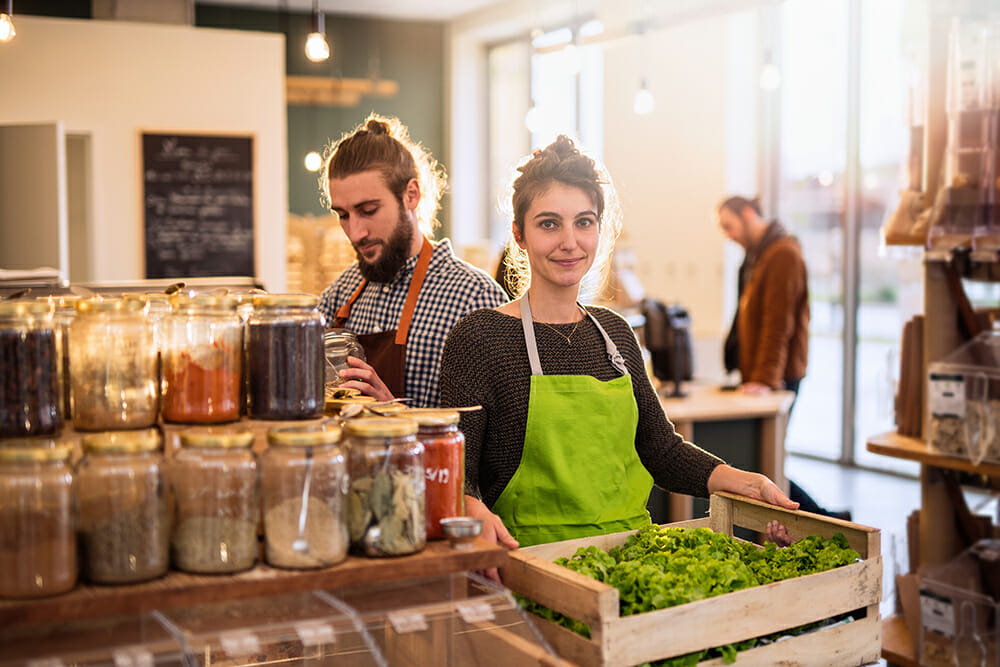 Man and women working in small wholefoods business