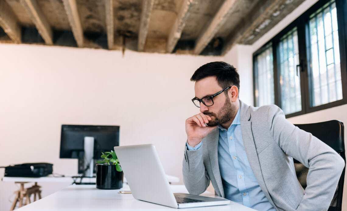 Smart man looking at computer screen