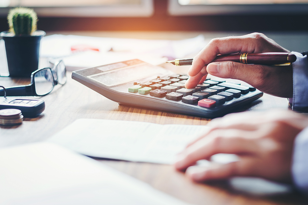 Calculating costs with a calculator