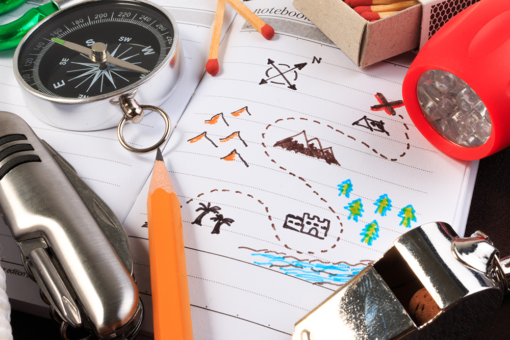 Scout gear. Map, compass, pencil, matches, whistle, torch and pen knife