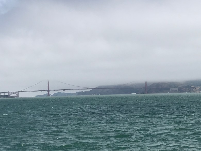 View of Golden Gate Bridge with clouds over the top of it