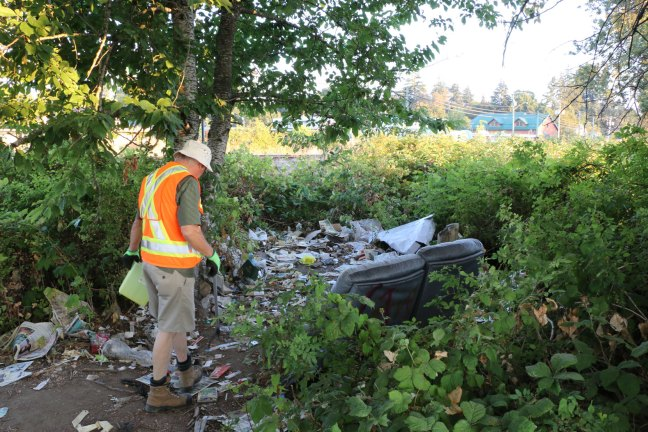 A Warmland Sharps Disposal Team member at a drug activity site off Duncan Street (photo by Duncan Taxpayers)