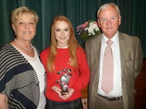 Badminton Star Roisin Moran receives her award from Billy Hannon and Ms Griffiths