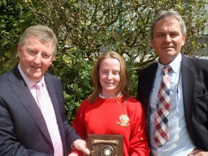 Derbhla Neenan wins the prize for best Junior Cert results 2015. She is pictured with Principal Gay McManus and Minister of State OPW and Flood Relief, Sean Canney
