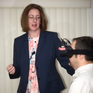 Audiologist Testing The Balance Of a Customer