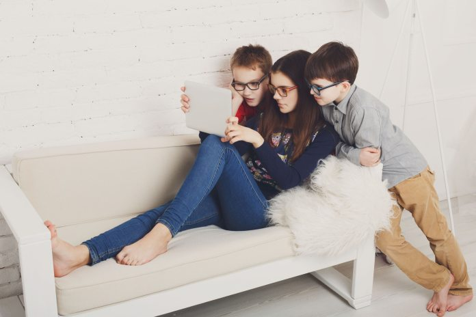 Kids in glasses with tablet, computer addiction