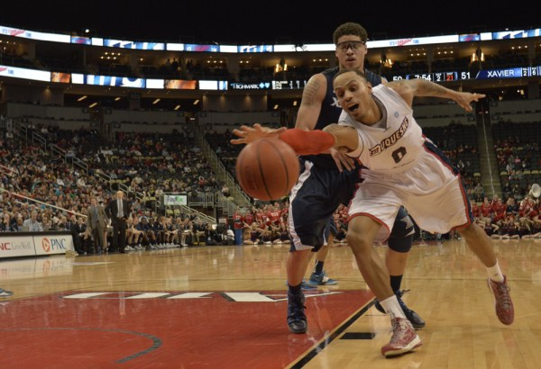 Connor Hancovsky / For The Duquesne Duke | Andre Marhold attempts keep the ball inbounds as the Dukes lose to Xavier, 73-65, Saturday evening at the Consol Energy Center. The Dukes have lost 11 straight games.