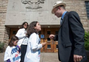 AP Photo. Republican candidate Josh Wander talks to his daughter Tamar, 9, in Squirrel Hill on May 21.