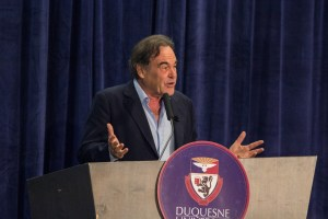 Photo by Aaron Warnick | Photo Editor. Movie director Oliver Stone presents on Friday evening at the Wecht Institute's JFK symposium. Stone, who directed JFK in 1991, spoke to the audience about Kennedy's legacy. The 50th anniversary of the assassination is on Nov. 22.