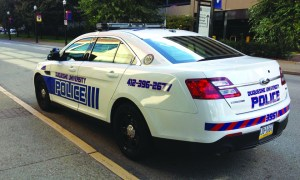 Photo by Andy Hornak | The Duquesne Duke. The public safety department's first new Ford Taurus Police Interceptor sits outside the Forbes Garage. The department plans to upgrade all cars by 2016.
