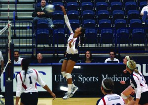 Claire Murray | The Duquesne Duke Marah Farage spikes the ball in Duquesne's 3-0 victory over George Washington University Friday night at the A.J. Palumbo Center.