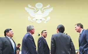 AP Photo. House Oversight Committee Chairman Rep. Darrell Issa, R-Calif. (center) speaks with Obama administration technology officials in Washington on Nov. 13.