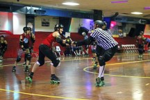 Photo by Claire Murray / Asst. Photo Editor - Two Steel City Roller Derby skaters dance in between bouts at Romp N' Roll in Glenshaw Sunday. SCRD had two bouts, the Mon Monsters vs. the Penn Bruisers and an annual Valentine's Day scrimmage, where the Black Hearts took on the Hopeless Romantics.
